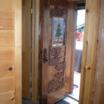 Carved Walnut door with stained glass