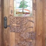Carved Walnut door with stained glass window